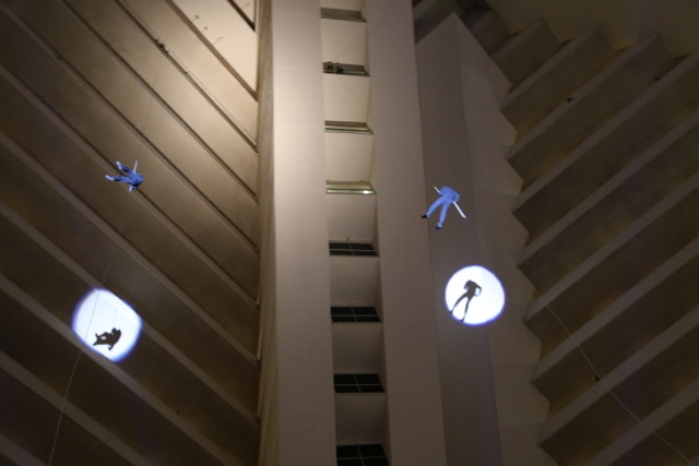 Blueman repelling down 28 stories inside the Luxor Hotel in Vegas